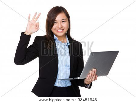 Asian businesswoman hold with laptop computer and ok sign gesture
