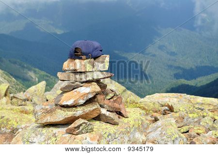 Cap rests on top of stones laid out the pyramid
