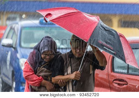 People Under Heavy Monsoon Rain