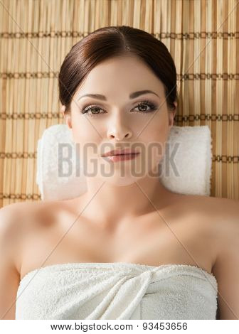 Young, beautiful and healthy woman in spa salon. Traditional oriental massage therapy and beauty treatments.