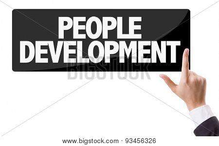 Businessman pressing button with the text: People Development