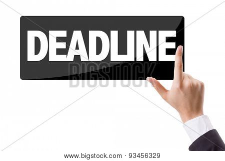 Businessman pressing button with the text: Deadline