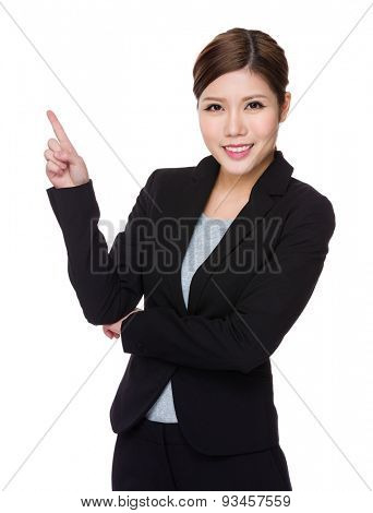 Young businesswoman showing finger point up