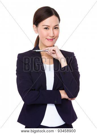 Confident Businesswoman holding a pen