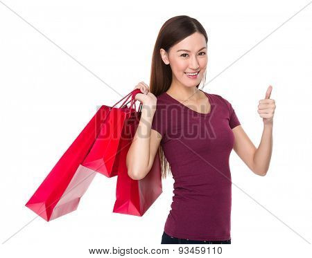 Asian woman holding with shopping bag and thumb up