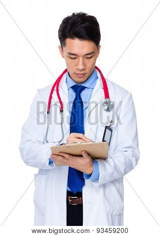 Doctor write on report