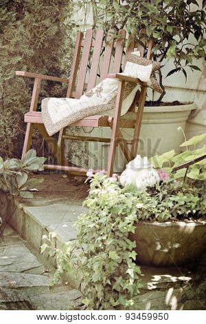 Rocking chair in a cottage garden setting. Double exposure with texture layer and instagram filter.