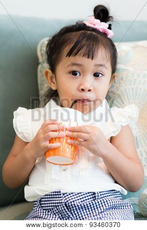 Girl drinking on sofa