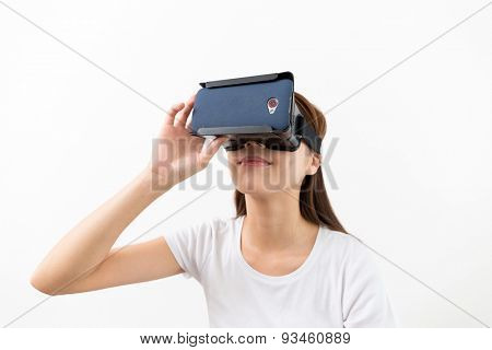 Young woman experience though VR device
