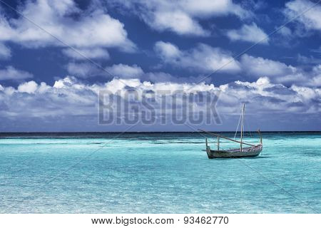Little boat in the sea, fishing in warm sunny day, beautiful landscape, amazing travel destination, summer vacation on Maldives, Asia