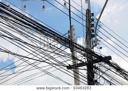 Strings Of Cables Connected To Wooden Poles