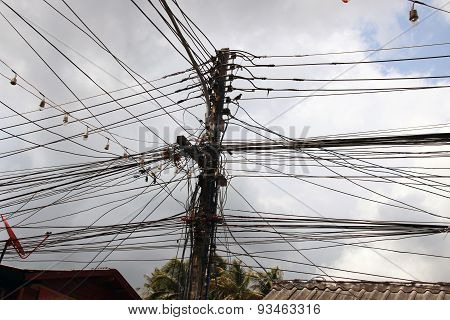 Strings Of Electricity Cables Connected To Wooden Pole