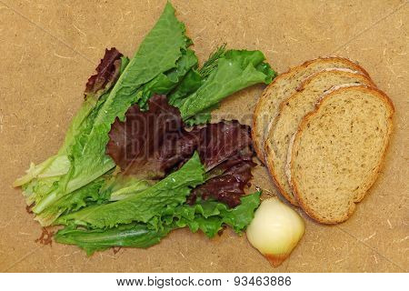 Fresh Salad Leafes And Bread On Wooden Background.