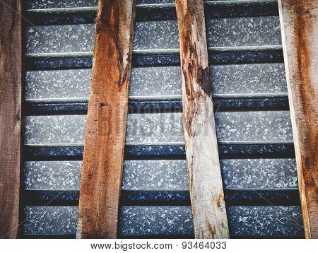 wooden boards on metal sheet