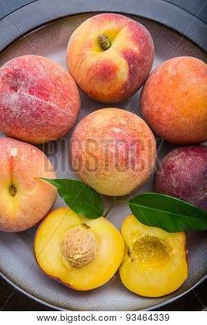 Ripe Juicy Peaches On A Plate Ready To Eat