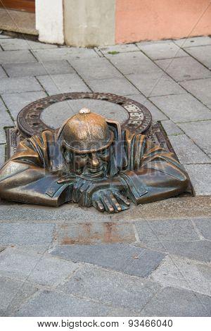 BRATISLAVA - OCTOBER 14, 2013: Cumil the sewage worker on October 14 in BRATISLAVA, Slovakia. Cumil is popular monument in Bratislava.