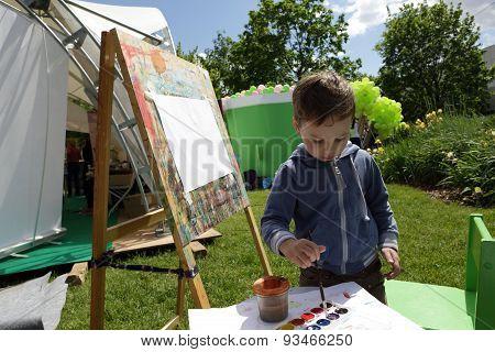 Boy Painting Paints