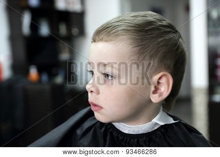 Serious Child At Hairdresser Salon