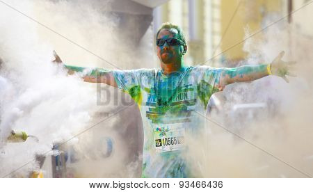 CLUJ-NAPOCA, ROMANIA - JUNY 13, 2015 : Crowds of unidentified people  at the Cluj-Napoca Color Run on Juny13, 2015. The Color Run is a 5k worldwide hosted fun race.