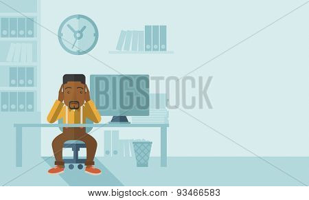 An overworked african-american businessman sitting infront of computer holding his head by two hands, under stress causing a headache. Unhappy concept. A contemporary style with pastel palette soft