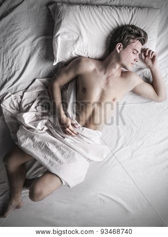 Guy lying in bed