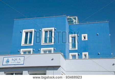 Blue building hosting the restaurant Aqua