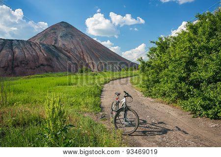 Slagheap and bike of ukrainian steppe