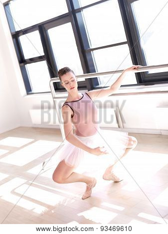Young Ballerina Doing Plie In Sunny Dance Studio