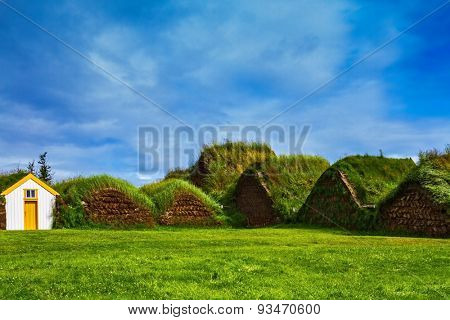 The village first settlers in Iceland. The reconstituted village - Pioneer Museum - Viking. Roofs of houses covered with grass