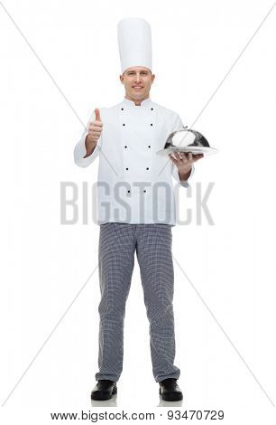 cooking, profession, gesture and people concept - happy male chef cook holding cloche and showing thumbs up