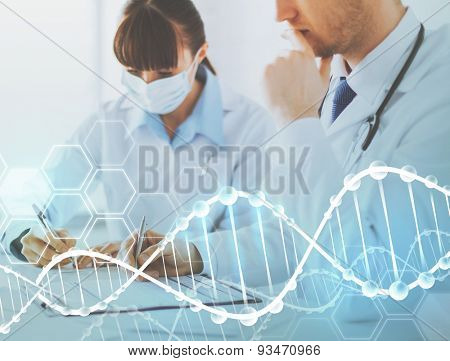 people, medicine, analysis and genetics concept - doctor and nurse writing prescription paper over dna molecule structure