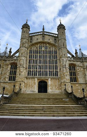 Low Angle View of Stairs and Facade of St Georges Chapel at Windsor Castle in England Framed by Blue Sky