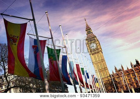 Angled View of Row of International Flags in front of Iconic Big Ben Clock Tower, Palace of Westminster, London, England, Colorized Image Enhancing Clouds Above Parliament Buildings