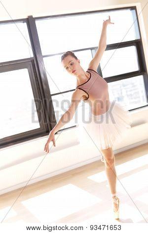 Graceful Ballerina En Pointe In Dance Studio