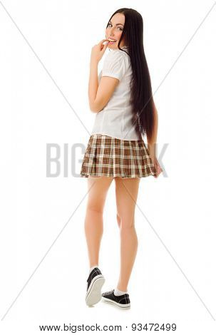 Young modest girl in plaid skirt isolated