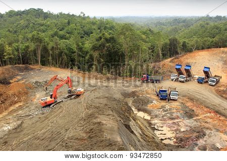 KUCHING, MALAYSIA - MAY 25 2015: Deforestation. Environmental damage to rainforest in Borneo, nature destroyed for oil palm plantations and construction.