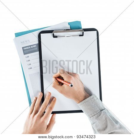 Businessman Writing Down Notes On A Clipboard
