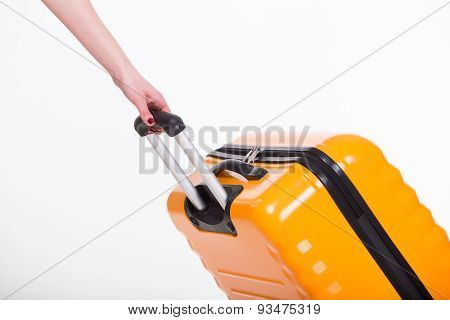 Hand holding travel case on white background