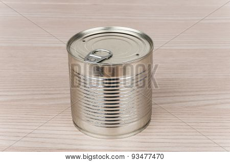 Closed Metal Cans With Ring On Table