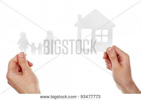Female hands holding paper house and family isolated on white