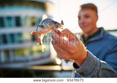 Man showing fish catched