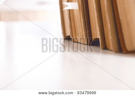 Stack of books on table close up