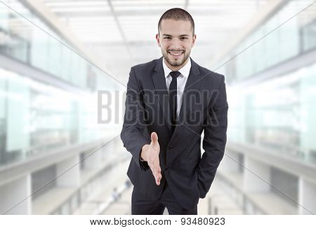 businessman offering to shake the hand at the office