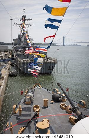 STATEN ISLAND, NY - MAY 24 2015: USS Barry (DDG 52) moored at Sullivans Pier as seen from the bridge of USCGC Spencer (WMEC 905) with the Verrazano Narrows Bridge in the background at Fleet Week 2015.