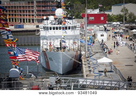 STATEN ISLAND, NY - MAY 24 2015: An overview of people walking by the USCGC Spencer (WMEC 905) a Medium endurance cutter and the Sullivans Pier during Fleet Week NY 2015.