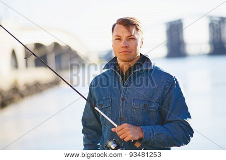 Man in posing with the light rod