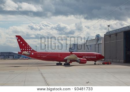 COPENHAGEN, DENMARK - MAY 13: Air Greenland A330 towed into hangar at Kastrup Airport, May 13th 2015. This Airbus A330 is the largest airliner of Air Greenland.