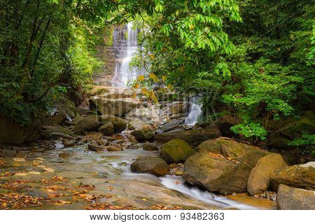 Waterfall And Stream In The Rainforest Of Borneo