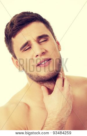 Handsome athletic man suffering from neck pain.