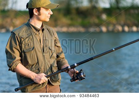 Portrait of a fisherman fishing on the river